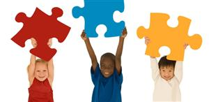 picture of children holding puzzle pieces