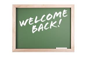 welcome back written on chalkboard