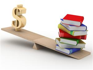 picture of books balanced with a dollar sign